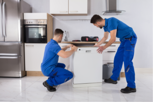 Movers lifting kitchen appliance